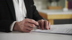 Businessman signs documents Stock Footage