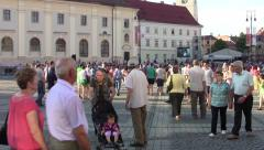 Plenty of people who wander through the city's central square 00 Stock Footage