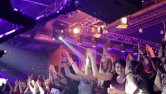 Group of girls applaud the in front of the stage favorite band 4105 - stock footage