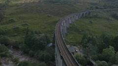 Aerial view of Glenfinnan steam railway Viaduct Scotland Stock Footage