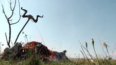 Funeral pyre decorated with ram horns placed in the middle of a field with lo - stock footage
