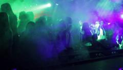 Pyrotechnical effects in front of the club scene who stand many girls and wom Stock Footage