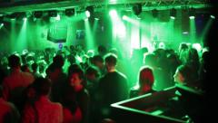 Group of young people dancing in club green light reflectors and laser Stock Footage