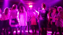 Group of young people dancing club in purple light reflectors 4138 - stock footage