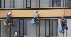 Washers Wash The Windows Of Modern Skyscraper 4k Stock Footage