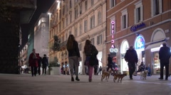 Lots of people walking on a street in Ancona during the night 2678 Stock Footage