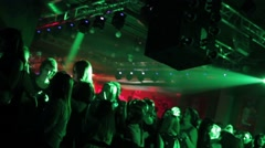 Group of young people dancing in club green light reflectors and laser 4052 Stock Footage