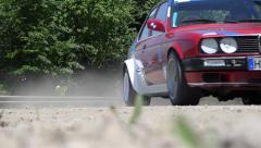 Red rally car passes a checkpoint in the wood 6979 Stock Footage