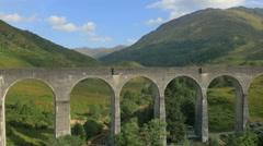 Aerial view of Glenfinnan railway Viaduct Scotland UK Stock Footage