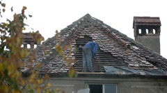 Workers covering a roof with tile 03 Stock Footage