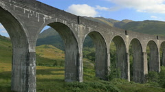 Aerial view of Glenfinnan steam railway Viaduct Scotland UK Stock Footage