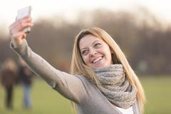 Girl taking selfies Kuvituskuvat
