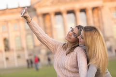 Friends making a selfie. Outdoors - stock photo