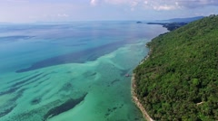 Aerial view of amazing beautiful island in Thailand. Clear water and waves - stock footage