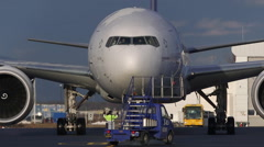 Huge Boeing 777 airplane at de-ice plattform Stock Footage