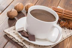 Mug filled with homemade hot chocolate, spice with walnut Stock Photos