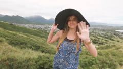 Close up portrait of beautiful young woman with hat at Pillbox Hike, Hawaii Stock Footage