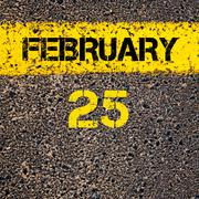 25 February calendar day over road marking yellow paint line - stock photo