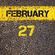 Stock Photo of 27 February calendar day over road marking yellow paint line