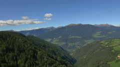 Aerial view Alpine forest valley road Italian Dolomites Italy - stock footage