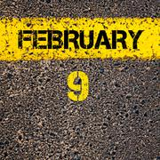 Stock Photo of 9 February calendar day over road marking yellow paint line