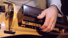 Man playing old accordion called Sanfona Hurdy-gurdy stringed musical instrument Stock Footage
