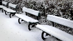 Park Benches Coverd in Snow During a Snowstorm Stock Footage