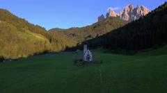 Aerial view St Johann chapel Alto Adige Dolomites Italy - stock footage