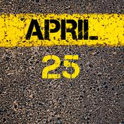 25 April calendar day over road marking yellow paint line - stock photo