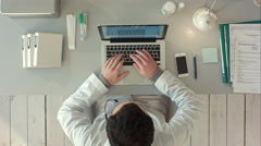 Top view of Medical worker with laptop. Doctors using keyboard at work Stock Footage