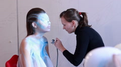 Bodypaint master paints model for photosession Stock Footage