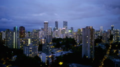 View of city skyline in Vancouver Canada at dusk - stock footage