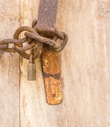 Old steel chain with padlock - stock photo