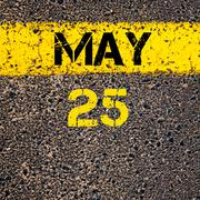 25 May calendar day over road marking yellow paint line - stock photo