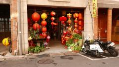 Small shop entrance, decorated with many chinese paper lantern lamps Stock Footage