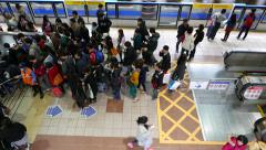 People crowd at staircase entrance, many passengers go down at metro station Stock Footage