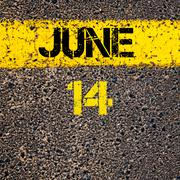 14 June calendar day over road marking yellow paint line - stock photo