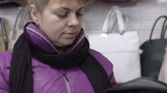 Woman chooses a bag at the store Stock Footage