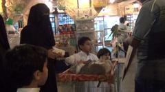 Boy buys rabbit at souq Waqif Stock Footage