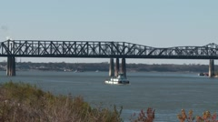 A barge slowly cruises under the historic I55 bridge in Memphis, TN Stock Footage