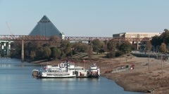 Construction on the Memphis Pyramid and an old riverboat Stock Footage