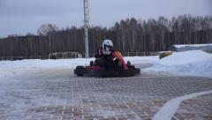 Karting goes to turn the camera to the side Stock Footage