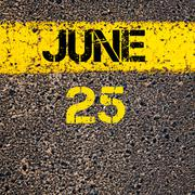25 June calendar day over road marking yellow paint line - stock photo