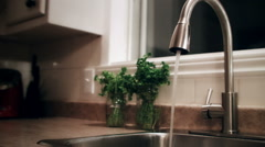 Man Closing the Faucet Valve Stock Footage