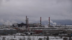 Winter smoke from the chimneys of the plant Stock Footage