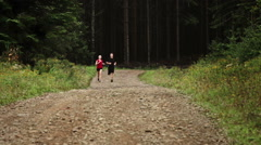 Couple Running alone in the Forest(Cinemagraph) Stock Footage