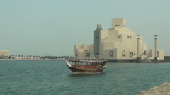 Museum of Islamic Art, sailing boat passing by Stock Footage