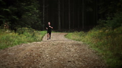 Man Running alone in the Forest Stock Footage