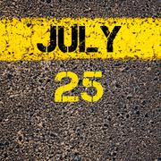 25 July calendar day over road marking yellow paint line - stock photo