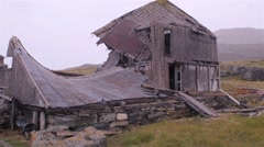 Abandoned house in Hebron, Newfoundland and Labrador on a snowy day. Stock Footage